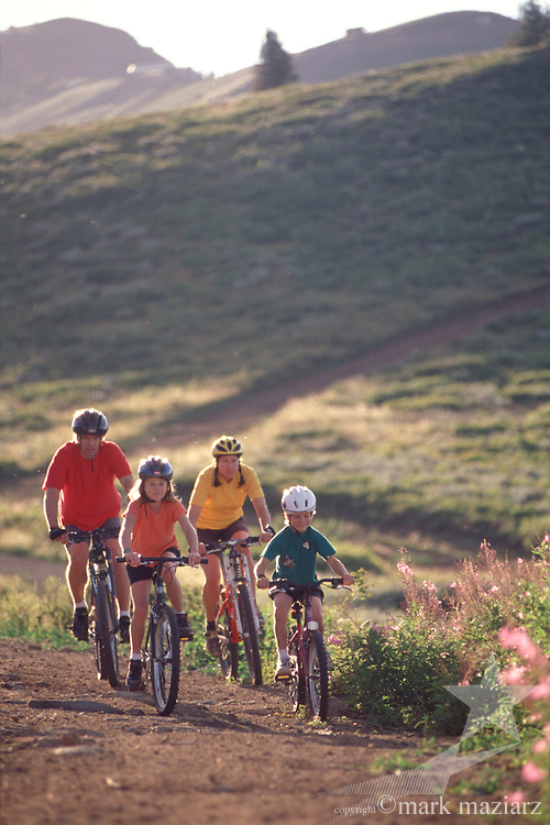 family riding in mountains above Park City, Utah, USA