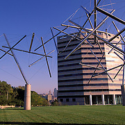 Missouri, Kansas City; Wire And Chrome Metal Sculpture At 2600 Grand Avenue; Liberty Memorial In Back