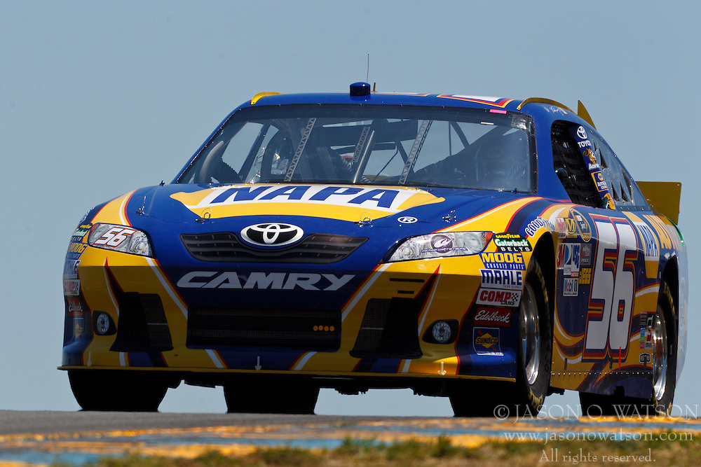 June 24, 2011; Sonoma, CA, USA;  NASCAR Sprint Cup Series driver Martin Truex Jr. (56) drives past turn 3 during practice for the Toyota/Save Mart 350 at Infineon Raceway.
