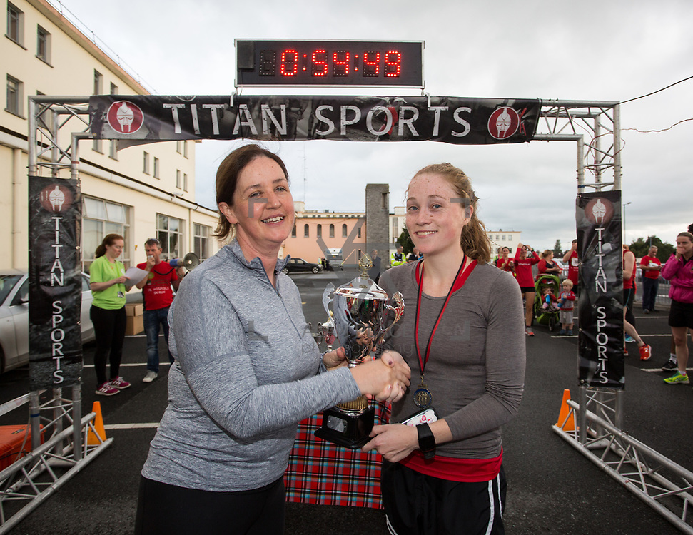 25.08. 2017.                                                      <br /> Almost 200 UL Hospitals Group staff, past and present, and members of the public completed the annual 5k Charity Run/Walk on Friday August 25th in Limerick.<br /> <br /> Mary Hannon, CNM2, Post Operative Care Unit presents the 1st place women's trophy to Shona O'Flynn, Dooneen A.C.<br /> <br /> <br /> Everybody who participated also raised funds for Friends of Ghana, an NGO formed last year by UL Hospitals Group and its academic partner the University of Limerick to deliver medical training programmes in the remote Upper West Region of Ghana. Picture: Alan Place