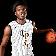 Guard Daiquan Walker poses during the Knights media day event at the University of Central Florida CFE Arena on Monday, October 7, 2013 in Orlando, Florida. (AP Photo/Alex Menendez)