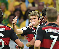 Thomas Muller of Germany celebrates scoring their first goal during the 2014 FIFA World Cup match at Mineir&atilde;o, Belo Horizonte<br /> Picture by Stefano Gnech/Focus Images Ltd +39 333 1641678<br /> 08/07/2014