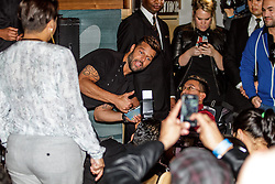 LOS ANGELES, CA - FEB 9 Latin Mega star Ricky Martin spends time with his fans by posing and signing autographs at The Grammy Museum  in Los Angeles, California USA. 2015 Feb 9. Byline, credit, TV usage, web usage or linkback must read SILVEXPHOTO.COM. Failure to byline correctly will incur double the agreed fee. Tel: +1 714 504 6870.