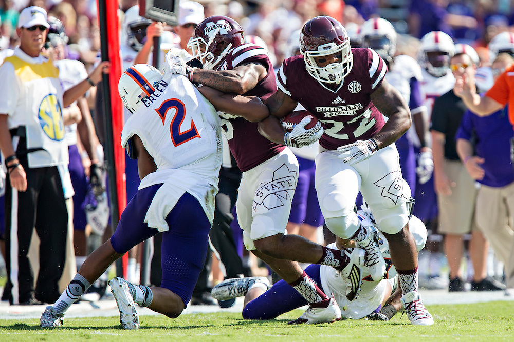 STARKVILLE, MS - SEPTEMBER 19:  Malik Dear #22 of the Mississippi State Bulldogs runs the ball and avoids the tackle of Adam Jones #3 of the Northwestern State Demons at Davis Wade Stadium on September 19, 2015 in Starkville, Mississippi.  The Bulldogs defeated the Demons 62-13.  (Photo by Wesley Hitt/Getty Images) *** Local Caption *** Malik Dear; Adam Jones