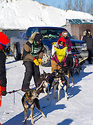 Volunteers help Matt Groth of Grand Marais, MN, prepare for his ten-dog class sled race on Sunday, 2 Feb 2014. Scenes from the Apostle Islands Sled Dog Race, hosted by the Bayfield Chamber of Commerce, near Bayfield, WI