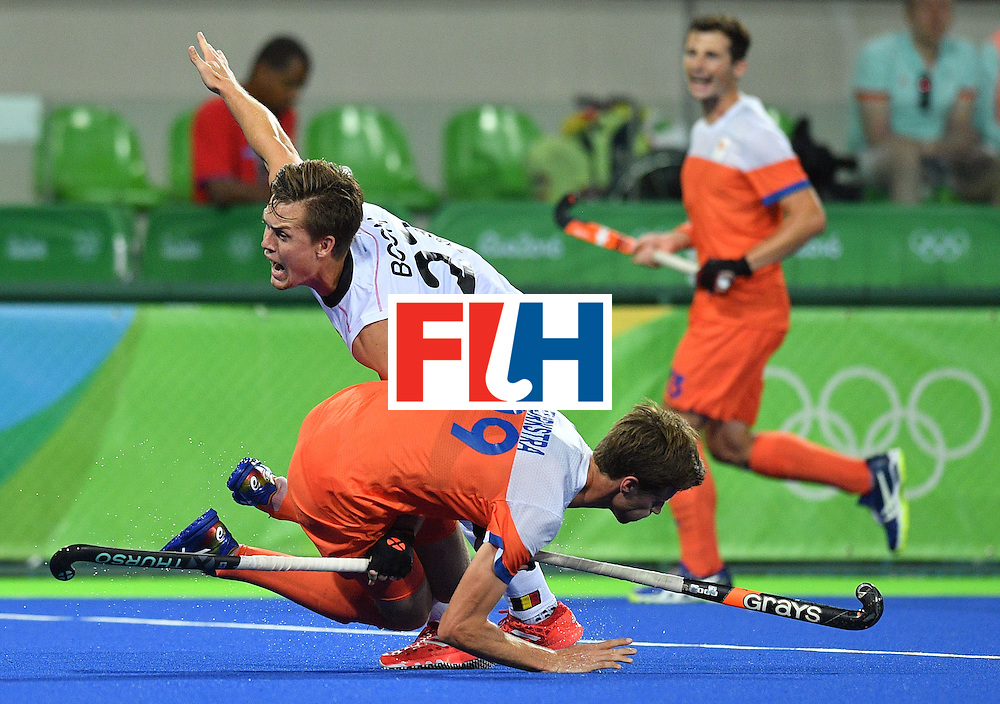 Netherland's Hidde Turkstra (bottom) vies with Belgium's Tom Boon during the men's semifinal field hockey Belgium vs Netherlands match of the Rio 2016 Olympics Games at the Olympic Hockey Centre in Rio de Janeiro on August 16, 2016. / AFP / Carl DE SOUZA        (Photo credit should read CARL DE SOUZA/AFP/Getty Images)