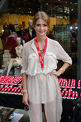 © Licensed to London News Pictures. 19/08/2012. London,UK.  Millie Mackintosh, of reality TV show Made in Chelsea, poses with a medial having just participated in exclusive fundraising walk The Sunday Strut, in aid of The Princes Trust. Photo credit : Richard Isaac/LNP