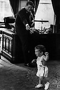 John Fitzgerald Kennedy (May 29, 1917 – November 22, 1963), 35th President of the United States, serving from 1961 with his son at the White House