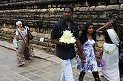 Pilgrms approach the Temple of the Tooth, Kandy, Sri Lanka