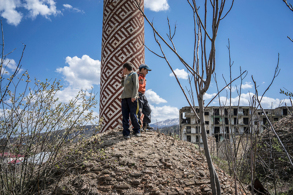 SHUSHI, NAGORNO-KARABAKH - APRIL 19: Hayk Harutyunyan (L), 7, and Vanya Hambartzumyan, 10, play amid the ruins of the Lower Mosque on April 19, 2015 in Shushi, Nagorno-Karabakh. Since signing a ceasefire in a war with Azerbaijan in 1994, Nagorno-Karabakh, officially part of Azerbaijan, has functioned as a self-declared independent republic and de facto part of Armenia, with hostilities along the line of contact between Nagorno-Karabakh and Azerbaijan occasionally flaring up and causing casualties. (Photo by Brendan Hoffman/Getty Images) *** Local Caption *** Hayk Harutyunyan;Vanya Hambartzumyan
