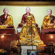 Statues on the main altar at Tran Quoc Pagoda on a small island on West Lake (Ho Tay). Originally built in the 6th century on the banks of the Red River, a changing course of the river forced the pagoda to be relocated in 1615 to Golden Fish (Kim Ngu) islet on the lake.