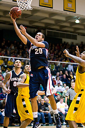 January 30, 2010; San Francisco, CA, USA;  Gonzaga Bulldogs forward Elias Harris (20) shoots against the San Francisco Dons during the second half at the War Memorial Gym.  San Francisco defeated Gonzaga 81-77 in overtime.