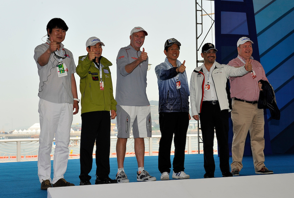Kim Dong Young, CEO Sail Korea, Kwang-Hoe Kim, Gyeonggi Provence Tourism Minister, Peter Gilmour, Yanmar Racing, Kim Moon Soo, Governor of Gyeonggi Province, WMRT Executive Chairman, Patrick Lim and Kjell Ortengren, President of Scania Korea Ltd wish the Pro-Am crews good luck. Photo:Chris Davies/WMRT
