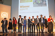 The business collective of Les Boîtes à Vélo receiving its award from Luke Ervine of Eurostar. The 2015 Ashden Awards ceremony held at the Royal Geographical Society, London. UK.