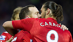 WEST BROMWICH, ENGLAND - Saturday, October 29, 2011: Liverpool's Charlie Adam celebrates scoring the first goal against West Bromwich Albion from the penalty spot with team-mate Andy Carroll during the Premiership match at The Hawthorns. (Pic by Vegard Grott/Propaganda)