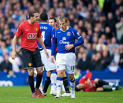 LIVERPOOL, ENGLAND - Saturday, October 25, 2008: Everton's Phil Neville is verbally abused by Manchester United's Rio Ferdinand who ran half the length of the pitch, but referee Alan Wiley took no action against the United player, as usual, during the Premiership match at Goodison Park. (Photo by David Rawcliffe/Propaganda)
