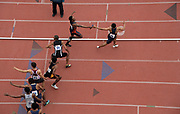 Apr 27, 2018; Philadelphia, PA, USA; Nathon Allen takes the handoff from Chiason Tenkiang on the anchor leg of the Auburn 4 x 400m relay that ran the fastest qualifying time of 3:07.72 during the 124th Penn Relays at Franklin Field.
