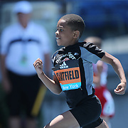 Amir Chatfield winning the 100m Men Fastest Kid in NYC race from Alana Moore who finished second in action at the Diamond League Adidas Grand Prix at Icahn Stadium, Randall's Island, Manhattan, New York, USA. 13th June 2015. Photo Tim Clayton