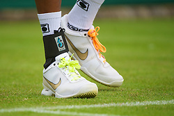 LONDON, ENGLAND - Monday, June 21, 2010: The multi-coloured shoe laces of Dustin Brown (JAM) during the Gentleman's Singles 1st Round on day one of the Wimbledon Lawn Tennis Championships at the All England Lawn Tennis and Croquet Club. (Pic by David Rawcliffe/Propaganda)