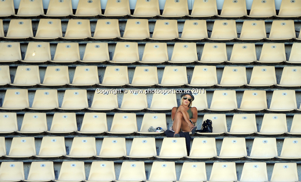 A lone cricket fan on day 1 of the first cricket test, New Zealand v Zimbabwe at McLean Park. Thursday 26 January 2012. Napier, New Zealand. Photo: Andrew Cornaga/Photosport.co.nz