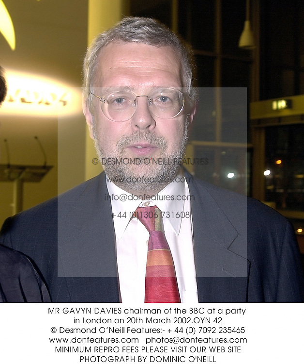 MR GAVYN DAVIES chairman of the BBC at a party in London on 20th March 2002.OYN 42