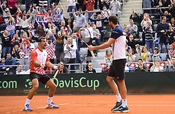 OSIJEK, Feb. 4, 2018  Marin Cilic (R) and Ivan Dodig of Croatia celebrate during the third match against Daniel Nestor and Vasek Pospisil of Canada at Davis Cup World Group first round match between Croatia and Canada in Osijek, Croatia, on Feb. 3, 2018. (Credit Image: © Marko Prpic/Pixsell/Xinhua via ZUMA Wire)