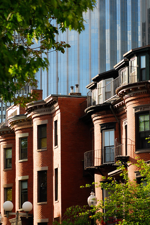 The modern 111 Huntington Tower stands over 19th century brownstones in Boston's South End.