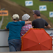 Trimmed umbrellas and family at the motocross track.