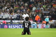 Real Madrid defender Marcelo (12) on knees after loss during the Champions League match between Tottenham Hotspur and Real Madrid at Wembley Stadium, London, England on 1 November 2017. Photo by Matthew Redman.