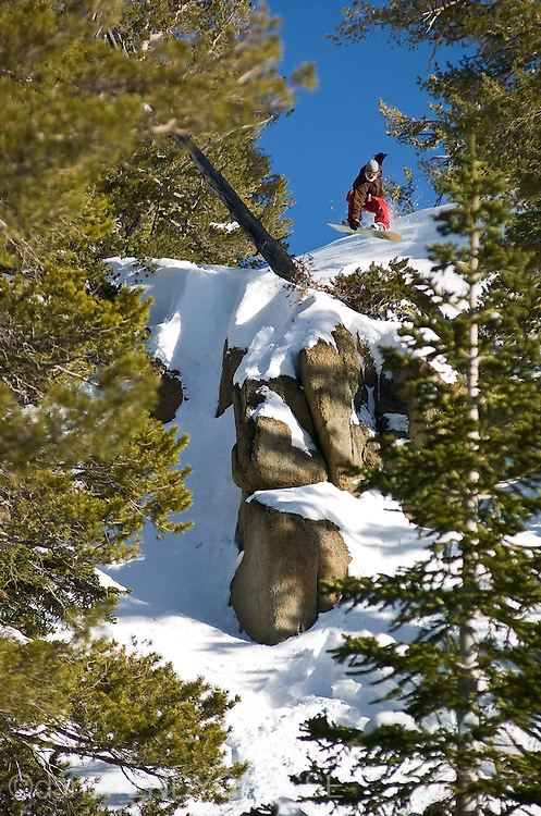 Professional Snowboarder Mads Jonsson, launches off a cliff in the backcountry near Lake Tahoe, California, USA.