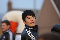 Pictured: Ki Sung Yueng. Tuesday 26 February 2013..Re: Thousands of Swansea City fans have lined the city's streets to welcome home their League Cup-winning heroes...The Swans, who are celebrating their centenary this season, beat Bradford City 5-0 in Sunday's Capital One Cup final at Wembley...The open-top bus parade started outside the Dragon Hotel at 4.30pm and finish at the Brangwyn Hall through the Kingsway and St Helen's Road before reaching its final destination about an hour later.