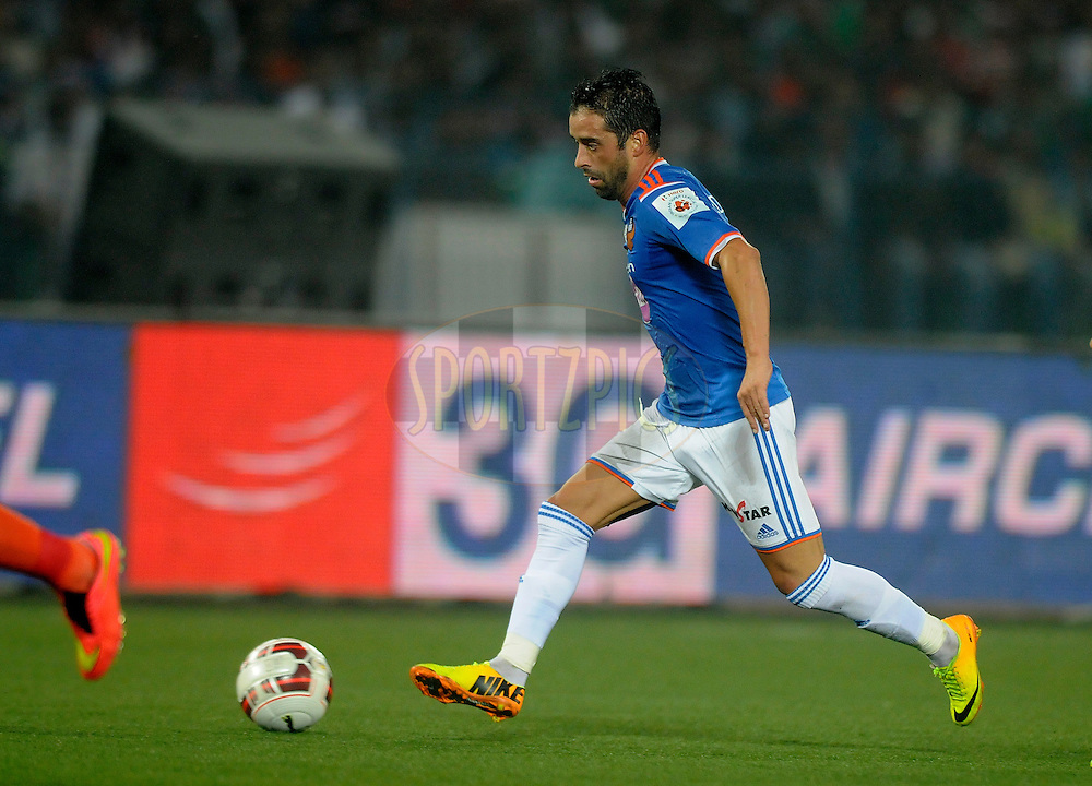 Edgar Carvalho Figueira Marcelino of FC Goa runs with the ball during match 55 of the Hero Indian Super League between AtlŽtico de Kolkata and FC Goa held at the Salt Lake Stadium in Kolkata, West Bengal, India on the 10th December 2014.<br /> <br /> Photo by:  Pal Pillai/ ISL/ SPORTZPICS