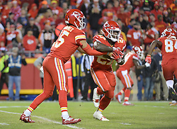 Oct 21, 2018; Kansas City, MO, USA; Kansas City Chiefs quarterback Patrick Mahomes (15) hands off to running back Kareem Hunt (27) during the second half against the Cincinnati Bengals at Arrowhead Stadium. The Chiefs won 45-10. Mandatory Credit: Denny Medley-USA TODAY Sports
