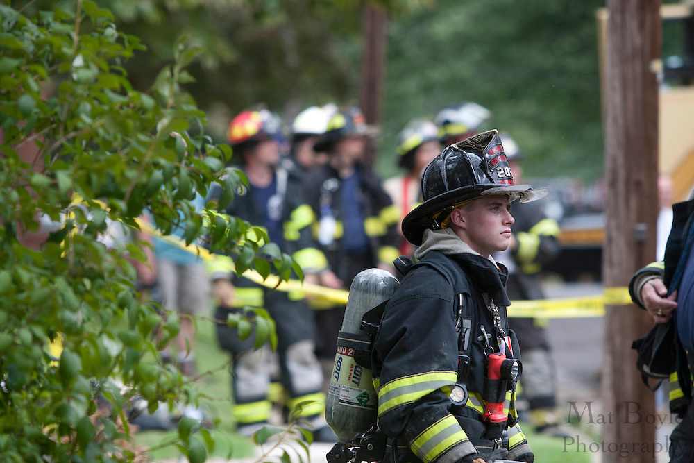 Firefighters from highland chemical engine company survey the damage caused by a fallen tree due to a gust of wind caused by the remnants of Hurricane Irene crushing the back of a house at 134 Lexington Avenue in Pitman NJ Sunday afternoon August 28 2011. Firefighters on the scene reported no injuries caused by the falling tree.