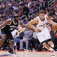 16 November 2013: Los Angeles Clippers power forward Blake Griffin (32) drives past Brooklyn Nets power forward Reggie Evans (30) during the Los Angeles Clippers 110-103 victory over the Brooklyn Nets at the Staples Center, Los Angeles, California, USA.