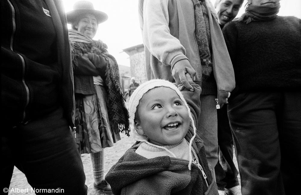 Children with big smile and big eyes in market looking up