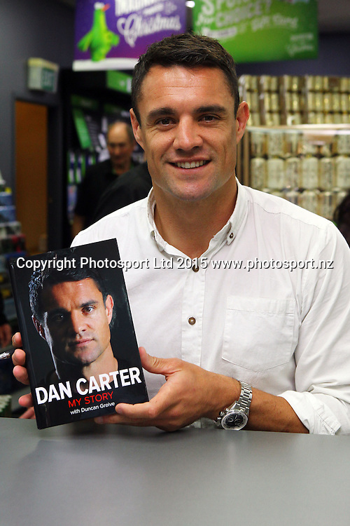 All Black Dan Carter during a signing session for his new book, Paper Plus Newmarket, Auckland. 17 November 2015. Copyright Photo: William Booth / www.photosport.nz