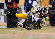PITTSBURGH - JANUARY 18: Troy Polamalu #43 of the Pittsburgh Steelers sacks Quarterback Joe Flacco of the Baltimore Ravens during the AFC Championship Game on January 18, 2009 at Heinz Field in Pittsburgh, Pennsylvania. The Steelers defeated the Raves 23 to 14 to advance to Super Bowl XLIII. (Photo by Rob Tringali//) *** Local Caption *** Troy Polamalu;Joe Flacco