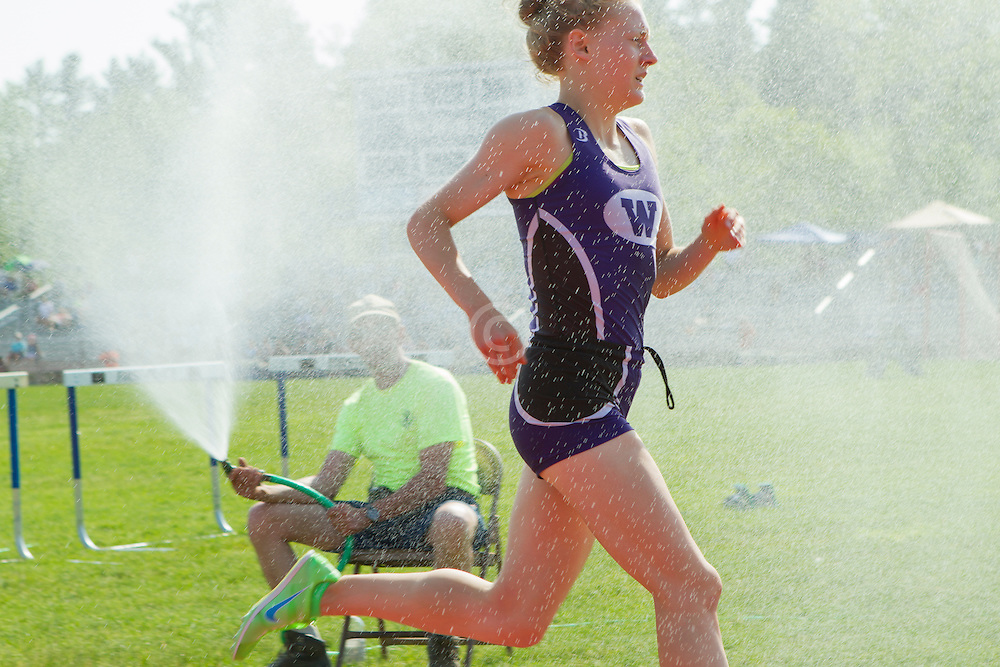 Bethanie Brown, Waterville, senior, girls 3200 meters, gets sprayed with water on 80 plus degree day; Maine State Track & FIeld Meet - Class B