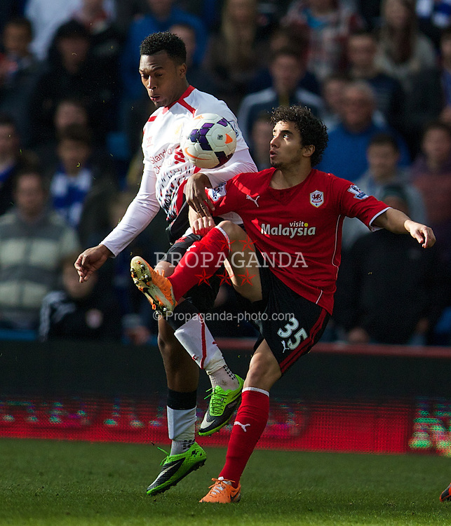 CARDIFF, WALES - Saturday, March 22, 2014: Liverpool's Daniel Sturridge in action against Cardiff City's Fabio Pereira da Silva during the Premiership match at the Cardiff City Stadium. (Pic by David Rawcliffe/Propaganda)