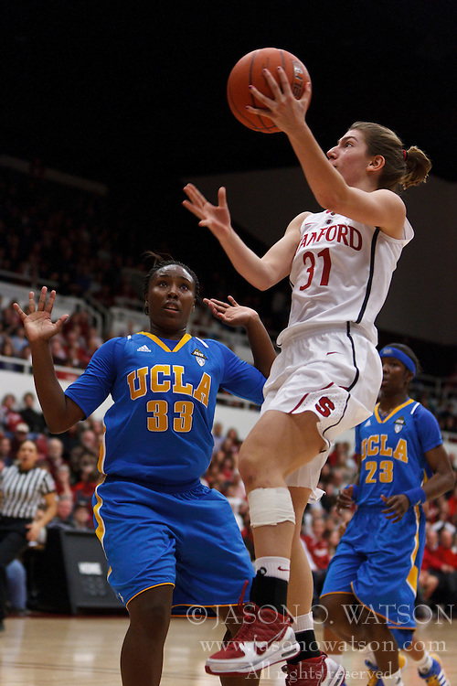 January 20, 2011; Stanford, CA, USA;  Stanford Cardinal guard Toni Kokenis (31) shoots past UCLA Bruins guard Jasmine Dixon (33) during the first half at Maples Pavilion.
