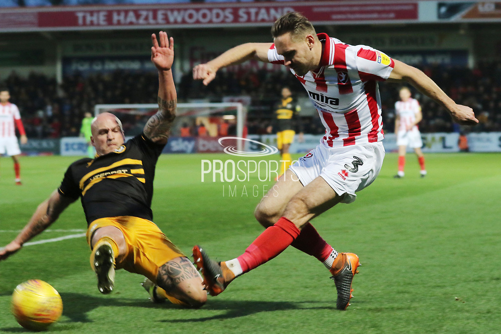 David Pipe and Chris Hussey   during the EFL Sky Bet League 2 match between Cheltenham Town and Newport County at LCI Rail Stadium, Cheltenham, England on 24 November 2018.