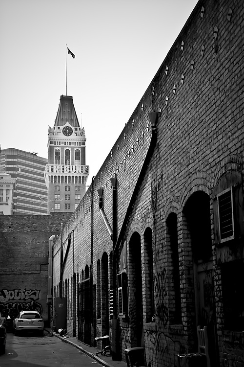 Alley downtown with Tribune Tower in background, in Oakland, CA..  Copyright 2008 Reid McNally.