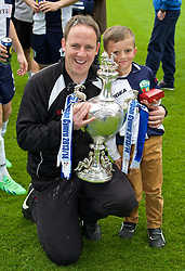 WREXHAM, WALES - Saturday, May 3, 2014: The New Saints' manager Carl Darlington and his son celebrate with the trophy after beating Aberystwyth Town 3-2 to win the Welsh Cup Final at the Racecourse Ground. (Pic by David Rawcliffe/Propaganda)