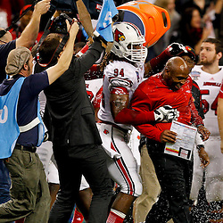 Jan 2, 2013; New Orleans, LA, USA; Louisville Cardinals head coach Charlie Strong is dunked by his players following a win over the Florida Gators in the Sugar Bowl at the Mercedes-Benz Superdome. Louisville defeated Florida 33-23. Mandatory Credit: Derick E. Hingle-USA TODAY Sports