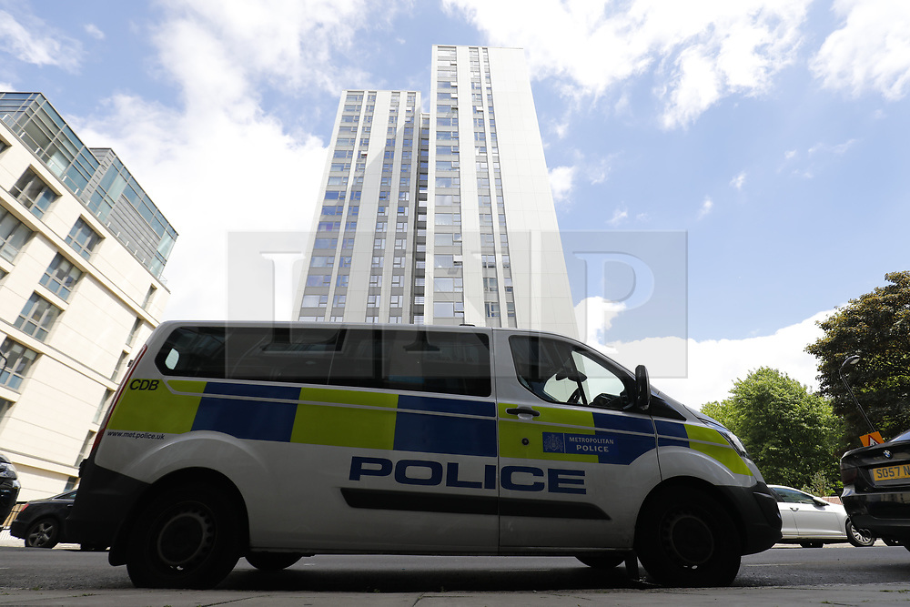 © Licensed to London News Pictures. 25/06/2017. London, UK. Police officers patrol around Chalcots Estate tower blocks in Camden, London on Sunday, 25 June 2017. The Camden Council ordered the evacuation of the towers but there are many residents refusing to leave even though the cladding of the buildings failed the fire safety test. Photo credit: Tolga Akmen/LNP