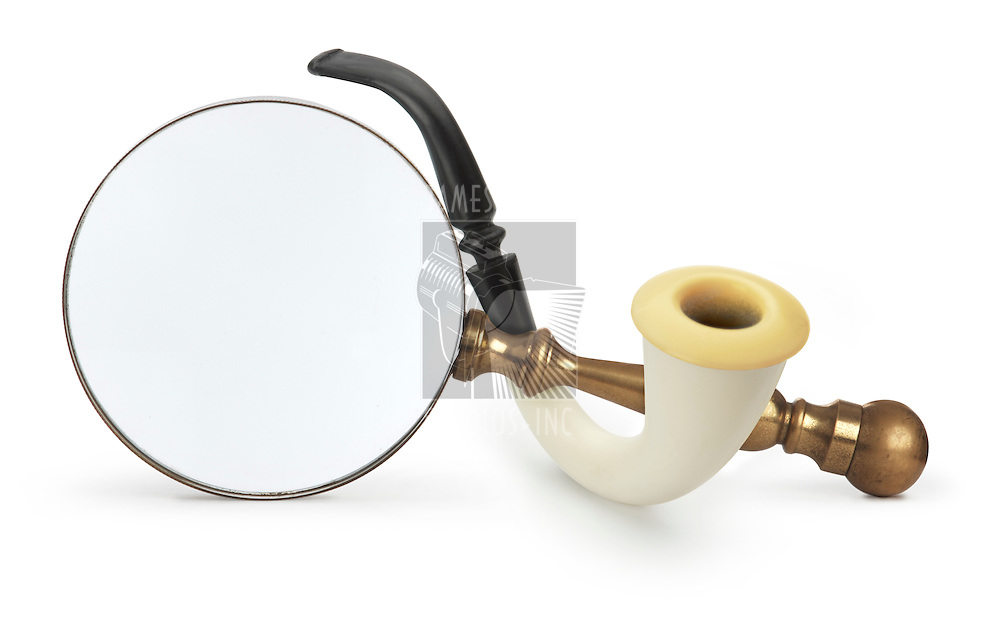 Vintage Magnifying glass with Sherlock Holmes Pipe isolated on white with a clipping path