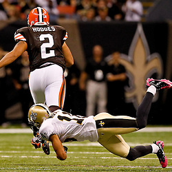 Oct 24, 2010; New Orleans, LA, USA; Cleveland Browns punter Reggie Hodges (2) runs past New Orleans Saints wide receiver Lance Moore (16) on a fake punt during the first half at the Louisiana Superdome. Mandatory Credit: Derick E. Hingle