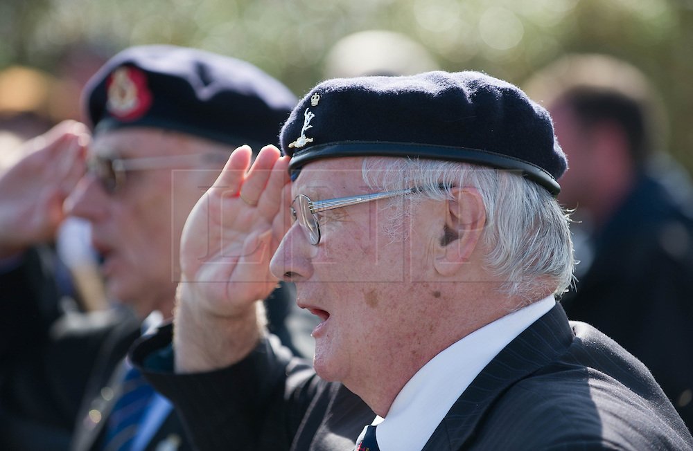© Licensed to London News Pictures. <br /> 28/08/2014. <br /> <br /> Durham Tees Valley Airport, United Kingdom<br /> <br /> Former soldiers salute during a short ceremony to mark a visit by one of only two remaining flying Avro Lancaster bombers at Durham Tees Valley airport today. <br /> <br /> The aircraft, 'Mynarski' is named after Pilot Officer Andrew Mynarski who flew with the Canadian Royal Air Force from the airport which was then called RAF Middleton St George.<br /> <br /> Pilot Officer Mynarski was posthumously awarded a VC after giving his life while trying to save a colleague when their Lancaster was shot down in June 1944.<br /> <br /> The famous World War Two aircraft is owned by the Canadian Warplane Heritage Museum and is beginning a 2-week tour of the UK.<br /> <br /> Photo credit : Ian Forsyth/LNP
