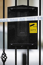 © London News Pictures. 21/05/2016. Weybridge, UK. A CCTV sign on the letter box of a property on the St George's Hill estate in Weybridge, Surrey where the body of a woman in her 30's was discovered by paramedics this morning (Sat). Photo credit: Peter Macdiarmid/LNP